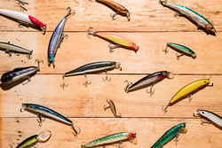Colorful fishing lures on wooden desk