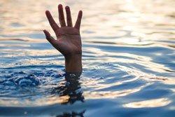 Drowning victims, hand of drowning man needing help