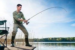 Fisherman catching fish angling at the lake