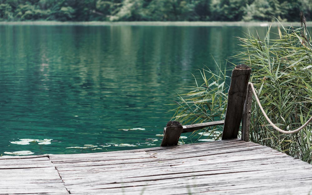 An old pier in front of beautiful lake