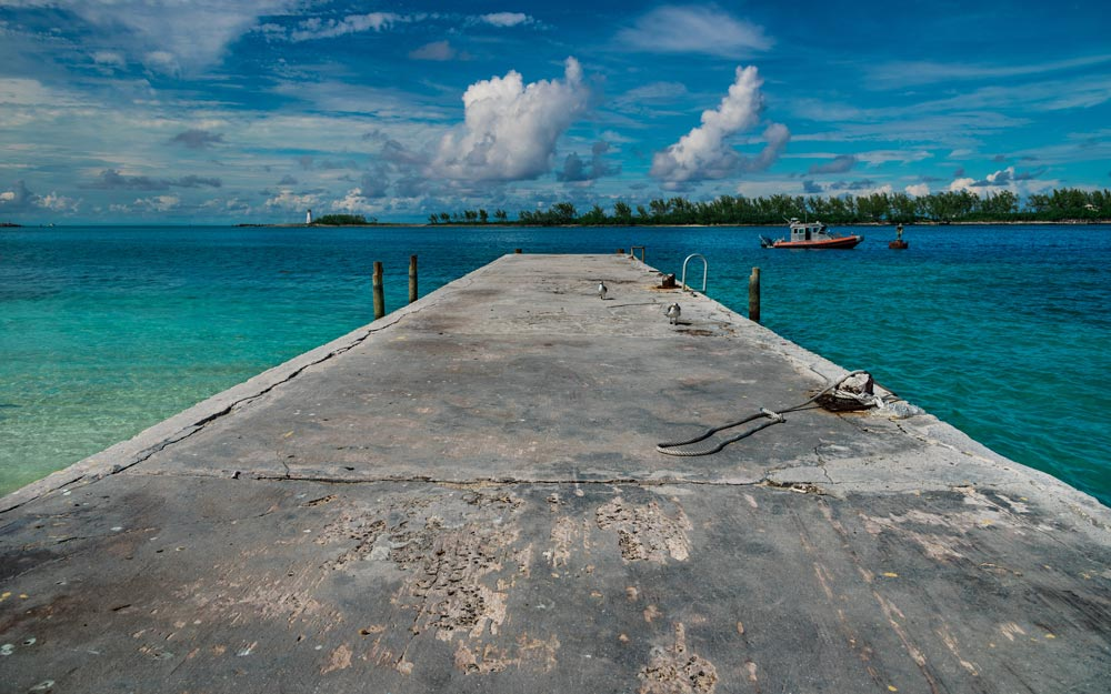 High angle shot of a pier with a cloudy blue sky in the background