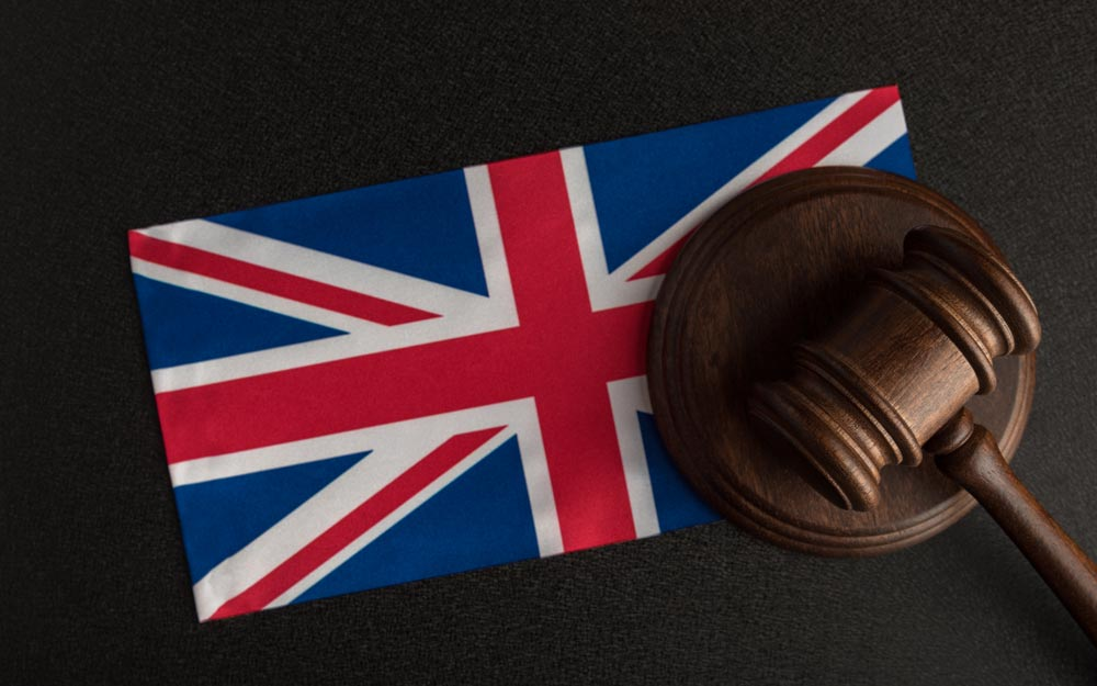 Judge gavel and flag of united kingdom.