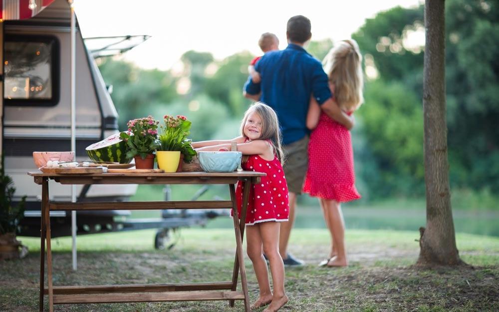 Little girl having fun at family picnic